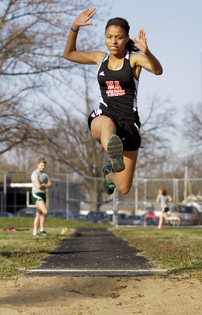 New Albany freshman Sandria Sawyers competes in the long jump during their home meet against Floyd Central on Tuesday. Staff photo by Christopher Fryer
