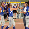 New Washington pitcher Whitney Morris is congratulated by teammates after striking out a Lanesville batter in the 1A Sectional championship. Morris struck out 17 batters in the win. Staff photo by C.E. Branham