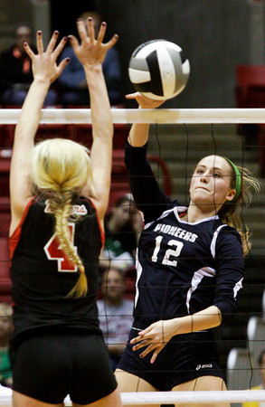 Providence freshman Jacquie Hornung attempts to score during their Class 2A state championship match against Wapahani at Worthen Arena in Muncie on Saturday. Wapahani won the match in four sets. Staff photo by Christopher Fryer