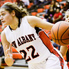 New Albany guard Lauren Camm drives to the basket during the Bulldogs' home game against Jeffersonville on Friday. Staff photo by Christopher Fryer