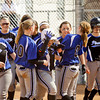 Charlestown's Alex Hutchinson is congratulated by her teammates after hitting a home run during their game against Crawford County at the Providence Invitational in Clarksville on Saturday. Charlestown won the game, 16-1. Staff photo by Christopher Fryer