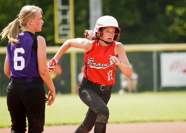 Borden freshman Taylor Streander moves towards third base on a steal during the Braves' 1-0 win over Lanesville at the Lanesville Sectional on Monday. Streander was safe on the play. Staff photo by Christopher Fryer
