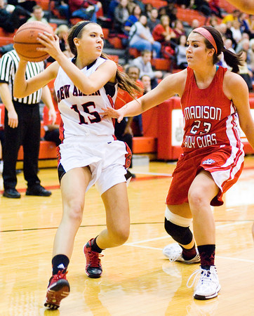 New Albany guard Jenna Shine drives to the basket during the Bulldogs' 39-33 loss to Madison at home on Thursday. Staff photo by Christopher Fryer