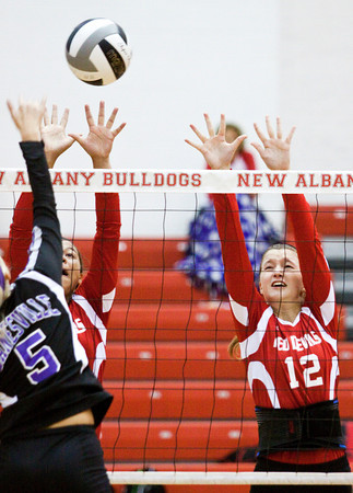 Jeffersonville High School's Makenzie Johnson, left, and Sam Grider attempt to block a shot by Lanesvile High School's Morgan Williams during their game in the River City Invitational At New Albany on Saturday morning. Jeffersonville won the match in two games. Staff photo by Christopher Fryer