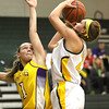 Floyd Central junior Riley Kaiser puts up a shot against Scottsburg Thursday night. Staff photo by C.E. Branham