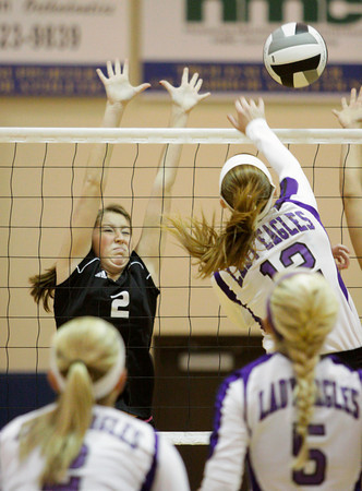 Borden sophomore Bailee Kruer goes up to block a shot by Lanesville junior Robyn Schoen during their match in the first round of the Class 1A Christian Academy of Indiana Volleyball Sectional tournament on Thursday. Staff photo by Christopher Fryer