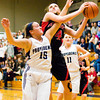 New Albany forward Claire Hirsch goes up for a shot during the Bulldogs' game at Providence on Friday. Staff photo by Christopher Fryer