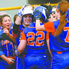 Silver Creek player Olivia Scarbrough (22) is welcomed at home plate after crushing a two-run homer against host Henryville on Monday afternoon. Staff photo by C.E. Branham