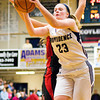 Providence Claire Rauck comes down with a rebound during the Pioneers' home game against New Albany on Friday. Staff photo by Christopher Fryer