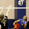 Christian Academy sophomore Brooklyn Garrison hits a shot past Rock Creek junior Susan McCoy during their match in the first round of the Class 1A Christian Academy of Indiana Volleyball Sectional tournament on Thursday. Christian Academy won the match in three sets, 25-17, 25-11 and 25-8. Staff photo by Christopher Fryer