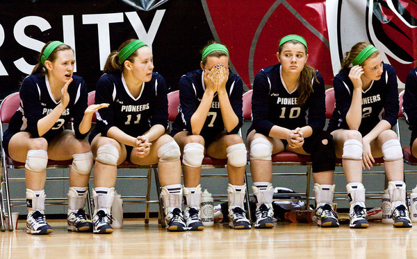 Players on the Providence bench look on during the final minutes of their Class 2A state championship match against Wapahani at Worthen Arena in Muncie on Saturday. Wapahani won the match in four sets. Staff photo by Christopher Fryer