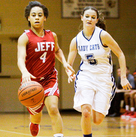 Junior Chelsea Lewis drives the ball downcourt during Jeffersonville's game at North Harrison on Friday. Staff photo by Christopher Fryer
