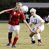 Jeffersonville sophomore Katie Wells settles the ball as she attempts to move past Corydon Central junior Elizabeth Satterfield during their game in the Indiana High School Athletic Association Girls Soccer Sectional at Floyd Central on Tuesday. Jeffersonville lost the game, 4-2. Staff photo by Christopher Fryer