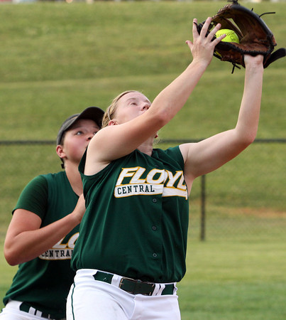 Floyd Central senior Samantha Feather catches a pop fly for an out while shortstop Taylor Batliner backs her up. Staff photo by C.E. Branham