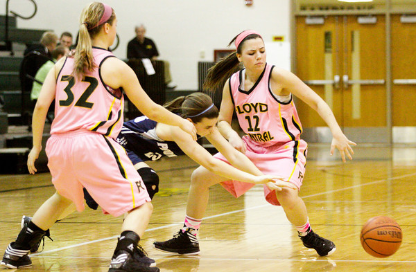 Floyd Central guard Shelby Rost strips the ball from Providence guard Marlee Karem during their game at Floyd Central on Thursday. Staff <br /> photo by Christopher Fryer