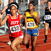 Jeffersonville sophomore Chelsea Lewis cruises to a win in a 100 meter dash preliminary in the IHSAA Track and Field sectional on Tuesday night. Staff photo by C.E. Branham
