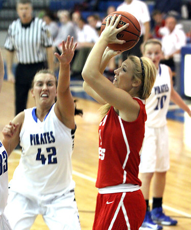 Jeffersonville sophomore Emily Gray puts up a shot against Charlestown Thursday night. Staff photo by C.E. Branham