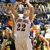 Silver Creek senior Alex Tinsley scores on the block against Floyd Central Thursday night. Staff photo by C.E. Branham