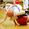Providence's Meredith Endris scrambles for a loose ball during their home game against Jeffersonville on Thursday. Jeffersonville won the game, 35-19. Staff photo by Christopher Fryer