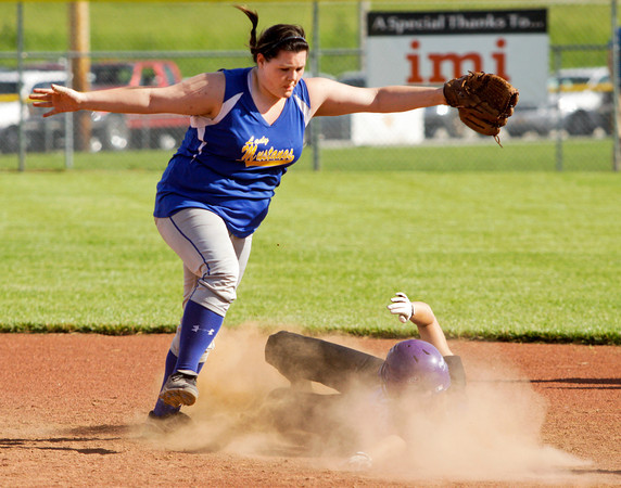 New Washington shortstop Brooke Shaw attempts to tag out Lanesville junior Emma Zeller at second base during the championship game of the Lanesville sectional tournament on Tuesday. Zeller was safe on the play and the Eagles went on to win the game, 1-0. Staff photo by Christopher Fryer