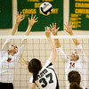 New Albany's Alexis Lete, left, and Nicole Jones attempt to block a shot by Floyd Central's Gwyn Jones during the first game of their match at Floyd Central on Thursday. Staff photo by Christopher Fryer