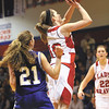 Borden guard Abby Ellis puts up a shot against Northeast Dubois in the final of the 1A West Washington regional Saturday night.  The Lady Braves lost to the Jeeps 35-31.  Staff photo by C.E. Branham