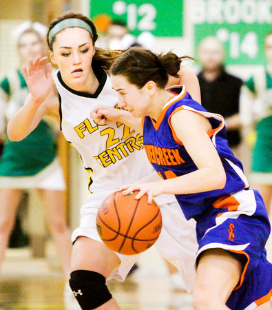 Floyd Central senior Riley Kaiser covers Silver Creek junior Alexis Barnett during their game at Floyd Central on Thursday. Staff photo by Christopher Fryer