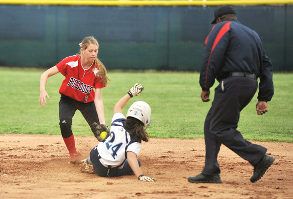 New Albany shortstop Hannah Veit gets the tag on the Pioneer's Jordyn Stengel as she attempted to steal second. The Bulldogs would take the 7-6 lead in the seventh inning, but the game was suspended due to rain.<br /> Staff photo by Tyler Stewart