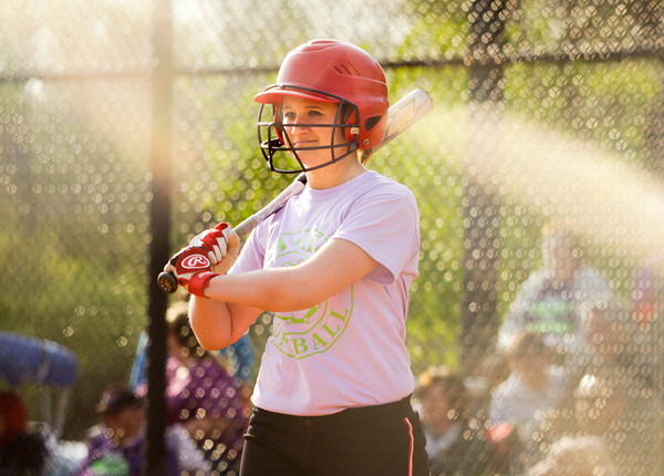 New Albany outfielder Sydney Michell looks to the third base coach while batting during their home game against Providence on Tuesday. Michell is currently battling hodgkins lymphoma, and the players and fans wore purple and lime green to the game to support her. Staff photo by Christopher Fryer