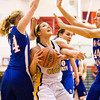 Floyd Central forward Madison Kaiser fights for a shot under the basket during their game against Jennings County in the New Albany sectional tournament on Friday. Floyd Central won the game, 52-46. Staff photo by Christopher Fryer