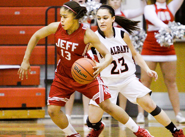 Jeffersonville guard Taylor Sykes drives the ball across the court during the Red Devils' game at New Albany on Friday. Staff photo by Christopher Fryer