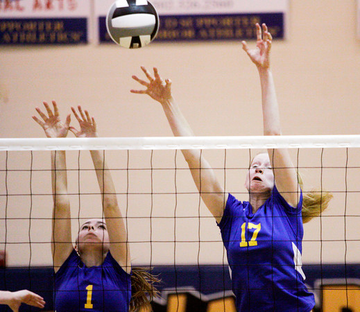 Christian Academy of Indiana freshman Alex Falcone, left, and senior Rachel Boesing attempt to block a shot during their regional tournament match against Trinity Lutheran at CAI on Tuesday. Trinity Lutheran won the match in four sets. Staff photo by Christopher Fryer