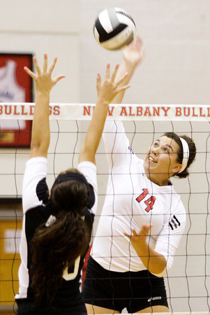 New Albany senior Nicole Jones spikes the ball against Brownstown Central junior Nicole Thomas during their match at New Albany on Thursday. Staff photo by Christopher Fryer