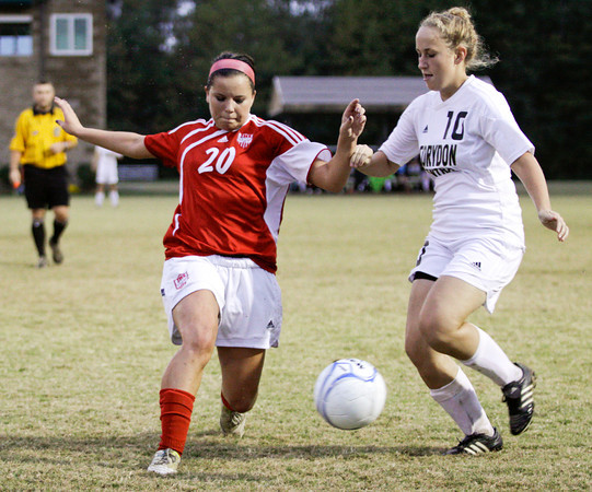 Jeffersonville junior Hailey Bates and Corydon Central senior Koko Sams struggle for possession of the ball during their game in the Indiana High School Athletic Association Girls Soccer Sectional at Floyd Central on Tuesday. Jeffersonville lost the game, 4-2. Staff photo by Christopher Fryer