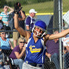 New Washington sophomore Ashley Johnson celebrates after scoring the winning run against Lanesville in the championship game of the IHSAA 1A Sectional at Lanesville. The Lady Mustangs won 1-0 in nine innings. Staff photo by C.E. branham