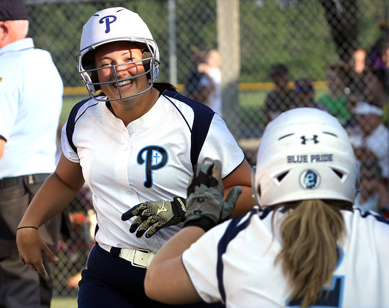 Providence senior Morgan Habermel is welcomed back to the dugout after driving in two runs and scoring in the first inning of the 2A Sectional final at Crawford County. Providence beat Paoli 6-4. Staff photo by C.E. Branham