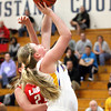 New Washington junior Caroline Ricks puts up a shot against jeffersonville Thursday night. Staff photo by C.E. Branham