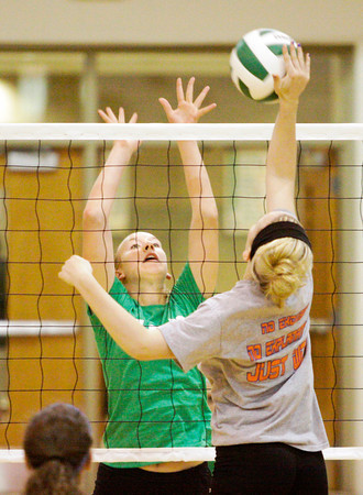 Floyd Central junior Hannah Joly attempts to block a shot by Silver Creek freshman Emily Reed during their scrimmage at Floyd Central on Wednesday. Staff photo by Christopher Fryer
