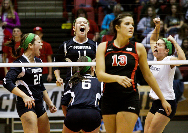 Providence celebrates after scoring a point during the first set of their Class 2A state championship match against Wapahani at Worthen Arena in Muncie on Saturday. Wapahani won the match in four sets. Staff photo by Christopher Fryer