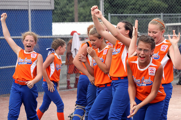 Members of the Silver Creek 11-12 All-Stars softball team celebrate after winning the District V championship thursday night over Jeff/GRC 4-0. Staff photo by C.E. Branham