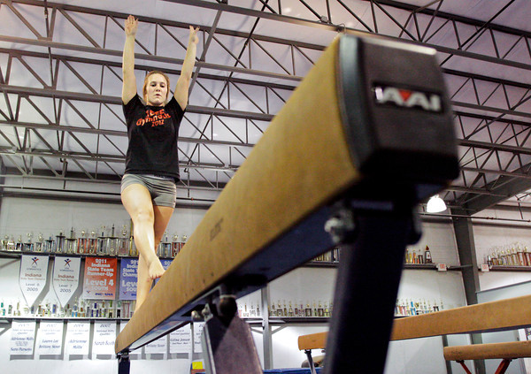 Jeffersonville senior gymnast Alexa Waldrip works on her balance bar routine during team practice at SIGS Sportsplex in New Albany on Wednesday. Staff photo by Christopher Fryer