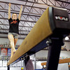 Jeffersonville senior gymnast Alexa Waldrip works on her balance bar routine during team practice at SIGS Sportsplex in New Albany on Wednesday. Staff photo by Christopher Fryer