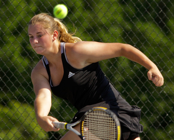 Borden High School senior Erin Mikel returns the ball to Silver Creek High School sophomore Kathleen Hebble during their No. 1 singles match at the Silver Creek sectional finals on Friday afternoon. Hebble won the match, 6-1, 6-3. Staff photo by Christopher Fryer