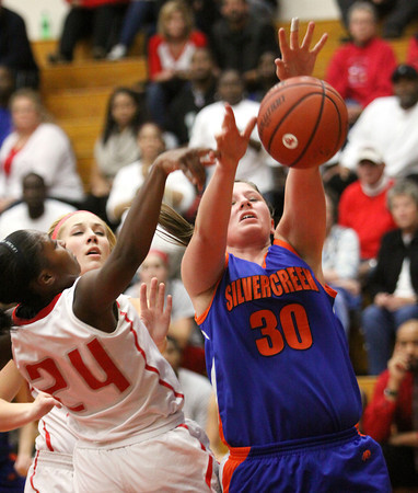 Silver Creek junior Casie Toby has her shot deflected by Jeffersonville guard Aurreeshae Hines Friday night at Jeff. Staff photo by C.E. Branham