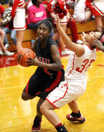 New Albany freshman Aaliyah Bell drives at Jeff Friday night.  Staff photo by C.E. Branham