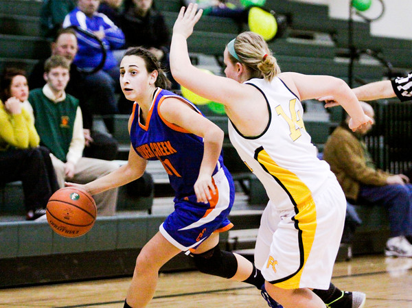 Silver Creek freshman Lauren Polston moves the ball downcourt during the Dragons' game at Floyd Central on Thursday. Staff photo by Christopher Fryer