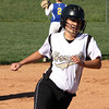 Henryville base runner Sarah Richey rounds third to score for the Hornets in a game against New Washington on Friday. Staff photo by C.E. Branham