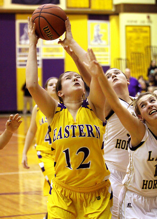 Eastern senior Krista Roberts grabs her own rebound against Henryville in the 2A Paoli Sectional. Staff photo by C.E. Branham