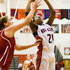New Albany forward Brianne Nixon goes up for a shot during the Bulldogs' home game against Bedford North Lawrence on Tuesday. Staff photo by Christopher Fryer