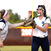 Providence pitcher Sierra Collett is congratulated by third baseman Baden Gillenwater after Collett snagged a line drive for an out. Staff photo by C.E. Branham